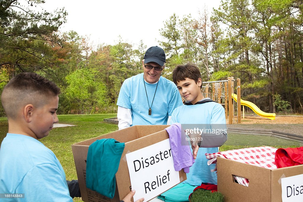 Children's sports team collecting donations for disaster relief victims. Volunteers. : Stock Photo