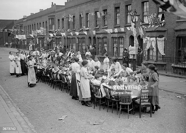 Children's tea party in an East End Street in London, to celebrate the Treaty of Versailles at the end of the First World War.