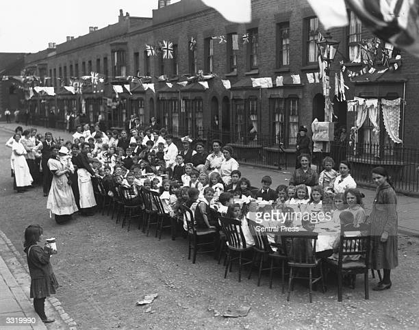 A children's tea party in an East End Street in London to celebrate the Treaty of Versailles at the end of the First World War