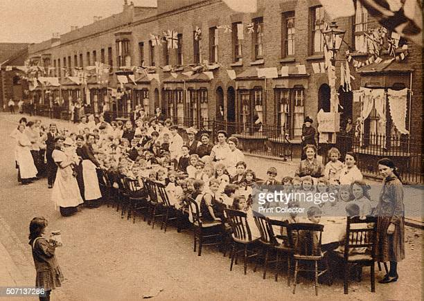 A children's tea party in an East End Street in London to celebrate the Treaty of Versailles at the end of the First World War' From These Tremendous...