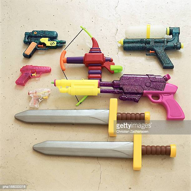 children's toy swords and guns. - sword stock pictures, royalty-free photos & images