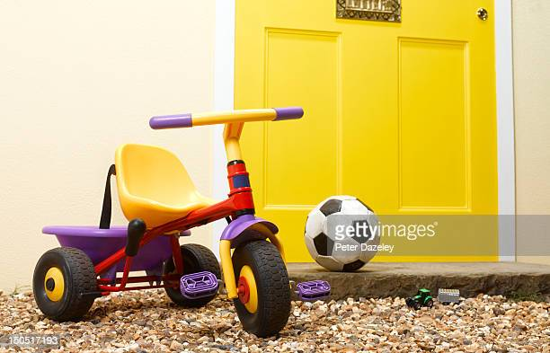 Children's toys on the doorstep of a house