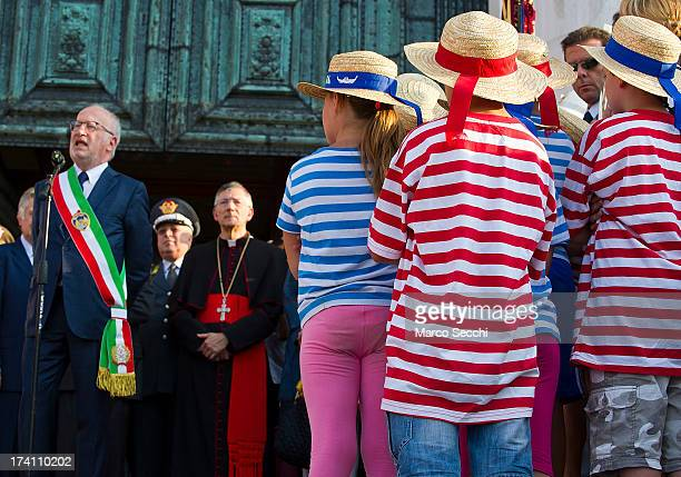 Childrens wearing gondoliers shirts listen to the speeches by the Major of Venice and the Patriarch of Venice during the opening of the Redentore...