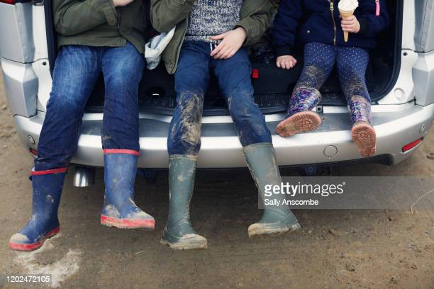 childrens wellington boots - dirty stock pictures, royalty-free photos & images