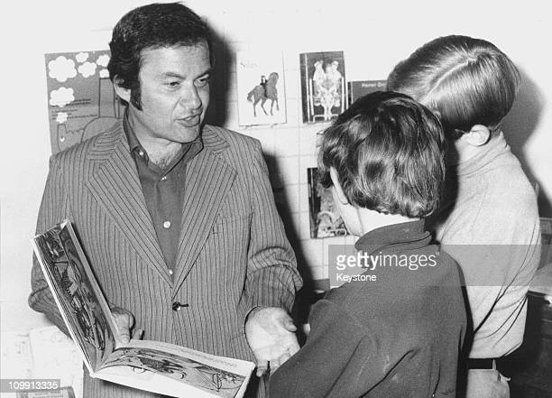 Children's writer and illustrator Maurice Sendak with his book 'Where the Wild Things Are' at the International Youth Library in Munich 9th June 1971