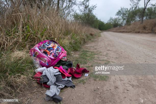 Child's abandoned backpack and clothing lie near an illegal river crossing point at the U.S.-Mexico border on March 24, 2021 in McAllen, Texas. A...