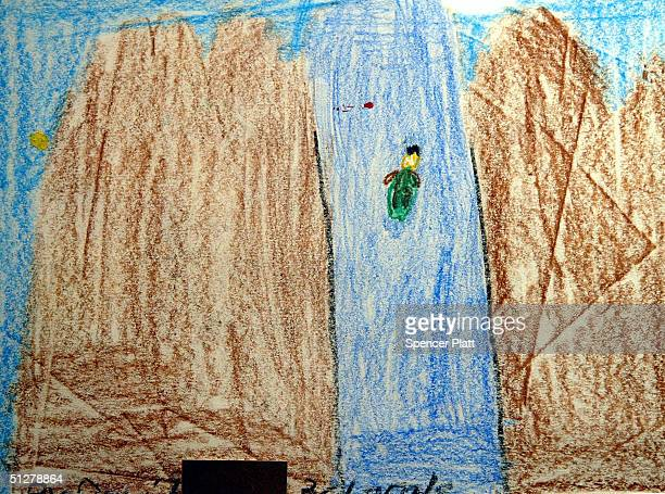 A childs artwork titled Canoeing in the Water is displayed at the Terrapin Chelsea Art Gallery September 9 2004 in New York City The artwork is part...