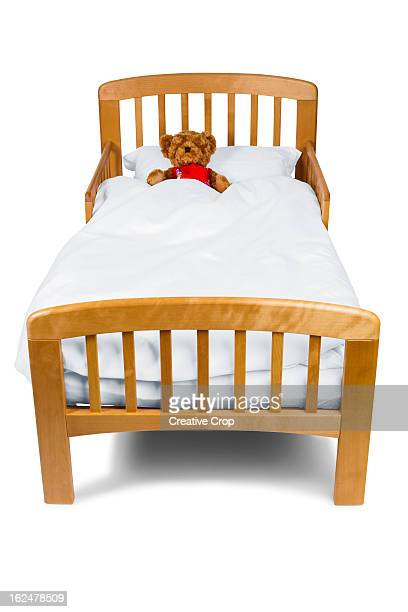 Child's bed, with teddy bear