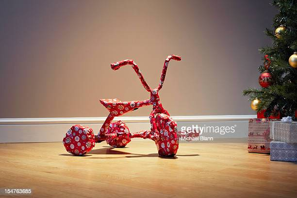 child's bicycle wrapped as a present for christmas - gifts stock pictures, royalty-free photos & images