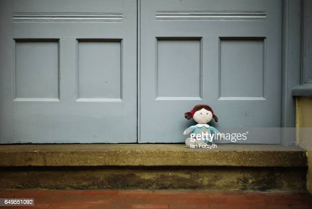 A child's doll is left on the step of a shop in Robin Hood's Bay on the North Yorkshire coast on March 8 2017 in Robin Hood's Bay United Kingdom...