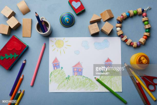 Childs drawing, coloured pencils and accessories