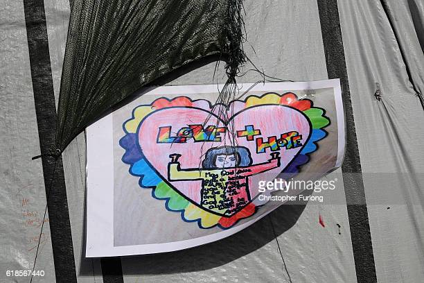 A childs drawing is left on the wall of a migrant shack in the now nearly deserted 'Jungle' migrant camp on October 27 2016 in Calais France The...