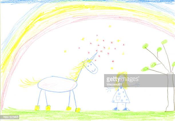 Childs drawing of unicorn and girl on paper