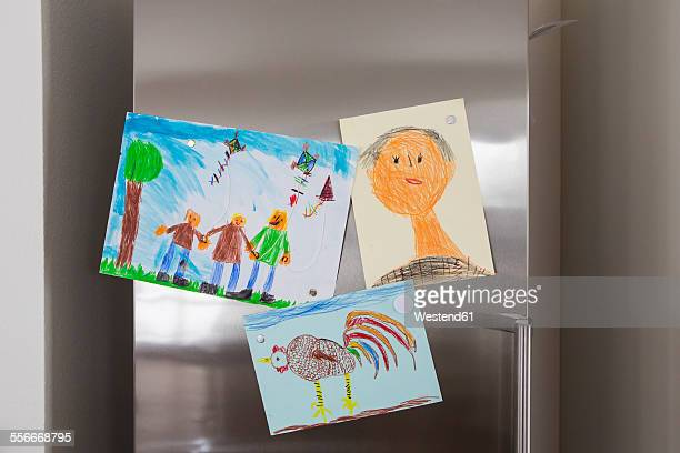 Childs drawings fixed at fridge