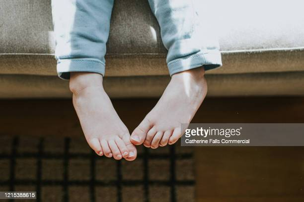 child's feet - footwear stock pictures, royalty-free photos & images