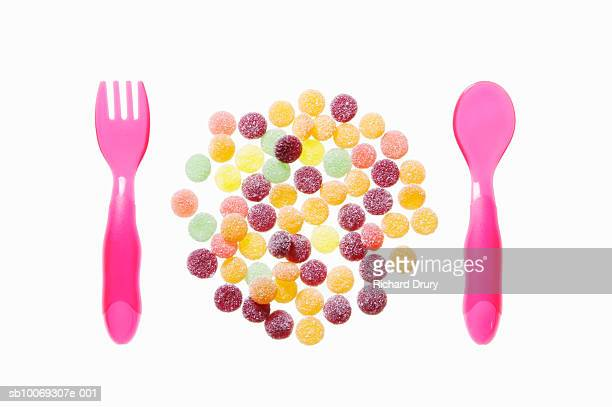 Child's Fork and Spoon with Circle of Sweets