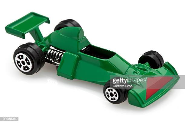 child's green toy race car - toy car stock pictures, royalty-free photos & images
