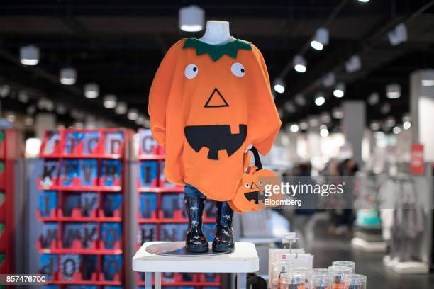 A child's Halloween pumpkin costume sits on display inside a Hema BV store in Tilburg Netherlands on Wednesday Oct 4 2017 Privateequity firm Lion...