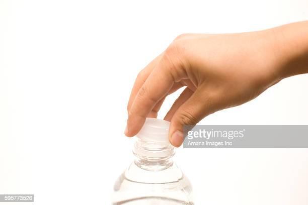 Child's hand closing water bottle cap