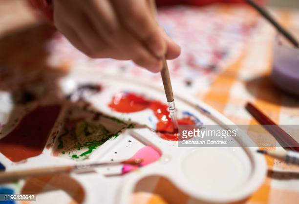 child's hand painting a white dove on a mural. concepts : learning; art; childhood; peace, painting. snapshot, selective focus, motion blur. - tempera painting stock pictures, royalty-free photos & images