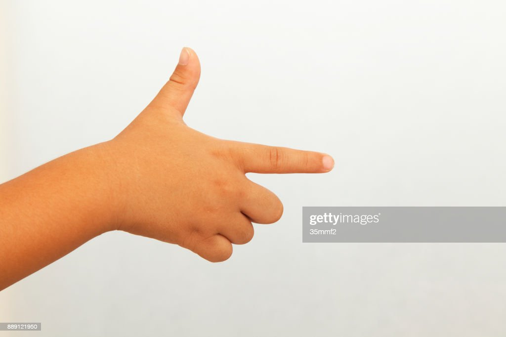 A child's hand pointing in the direction : Stock Photo