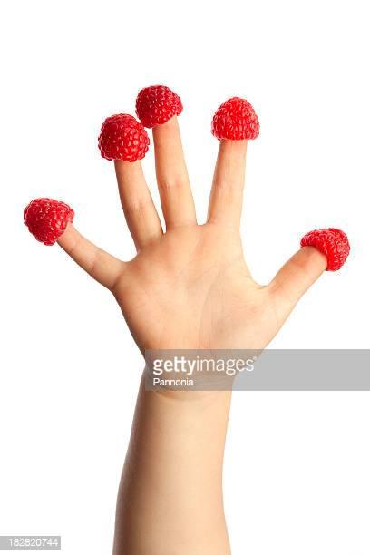 Child's Hand With Raspberry