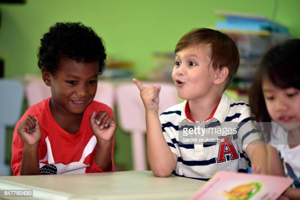 Childs  having fun learning  in an international school .Kindergarten, preschool, kids .