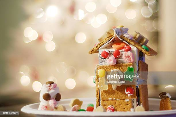 child's homemade christmas gingerbread house - milk carton stock photos and pictures