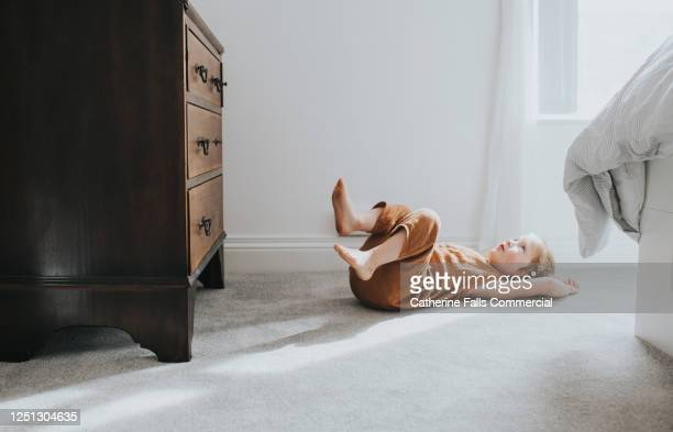 child's lying on grey thick pile carpet, casting shadow - nylon feet stock pictures, royalty-free photos & images