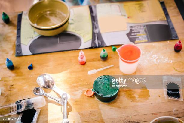 childs messy chemistry set science experiment on table with instructions - heshphoto stock pictures, royalty-free photos & images