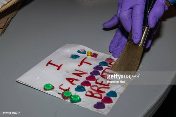 Child's note is dusted off at the Midwest Art Conservation Center on August 19, 2020 in Minneapolis, Minnesota. Community members are working with...