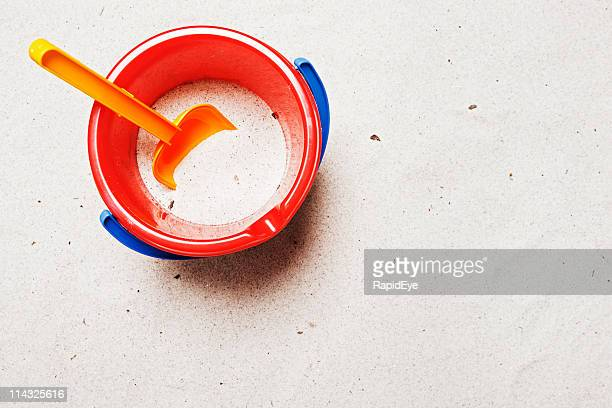 Child's pail and shovel with copy space | Beach background
