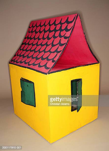 Child's playhouse against white background