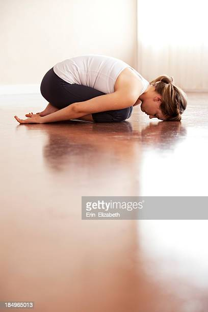 child's pose yoga - childs pose stock photos and pictures