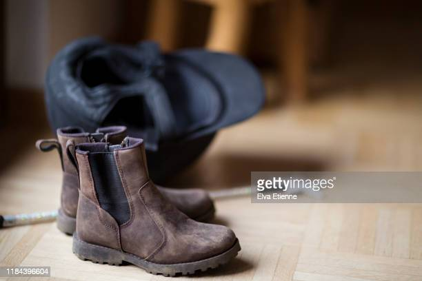 child's riding boots and helmet on a parquet flloor - riding hat stock pictures, royalty-free photos & images