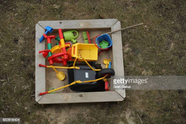 A child's sandbox lies filled with toys on a cold day on March 16 2018 in Berlin Germany