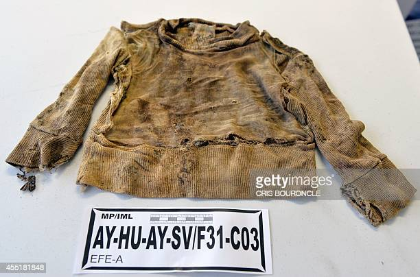 A childs shirt exhumed from a mass grave at Los Cabitos army base in the Ayacucho province more than 500 km from Lima into the southern Andes region...