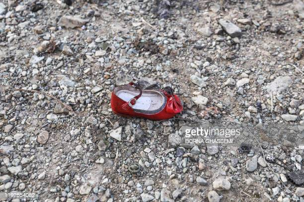 Child's shoe is pictured on January 8, 2020 at the scene of a Ukrainian airliner that crashed shortly after take-off near Imam Khomeini airport in...