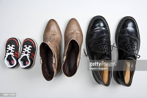 A child's shoes, a woman's boots and a man's shoes
