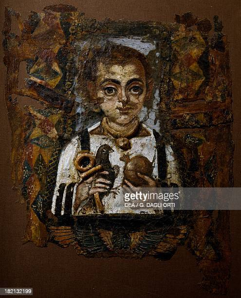 Child's shroud with the deceased depicted holding a bird an ankh and a pomegranate painted linen Egyptian civilisation Roman Empire 3rd century Paris...