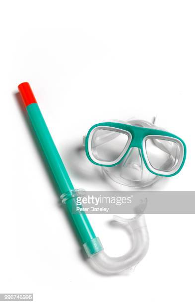 child's snorkel and goggles on white background - scuba mask stock pictures, royalty-free photos & images