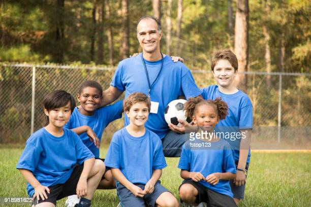 child's soccer team with coach. - soccer team stock pictures, royalty-free photos & images