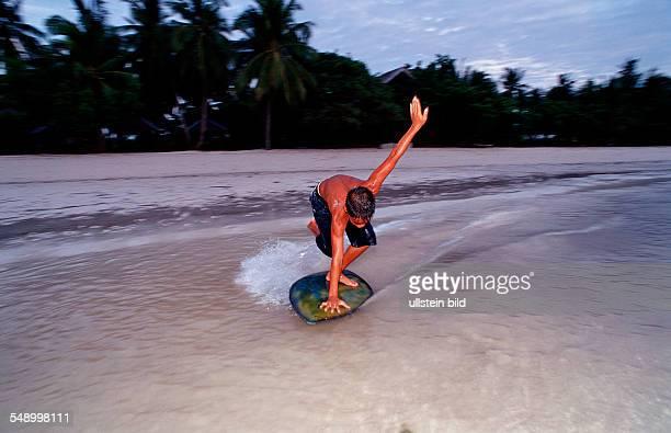 Childs surf on the beach Philippinen Bohol Sea Pacific Ocean Panglao Island Bohol