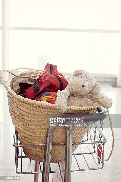 Child's teddy bear and other belongings in basket