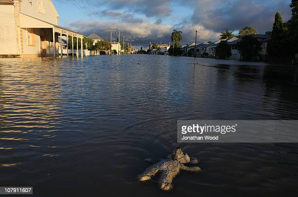 A childs toy floats in flood waters covering a suburban street at sunrise on January 7 2011 in Rockhampton Australia Floodwaters peaked at 92 metres...