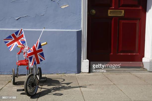 A child's tricycle stands decorated in Union flags also known as Union Jacks during a street party to celebrate the wedding of Britain's Prince Harry...