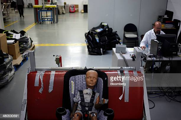 A childsized crash test dummy is pictured at the Dorel Technical Center car seat testing facility in Columbus Indiana US on Tuesday March 25 2014 The...