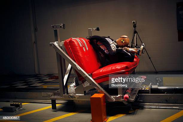 A childsized crash test dummy undergoes a 35 mile per hour crash test at the Dorel Technical Center car seat testing facility in Columbus Indiana US...