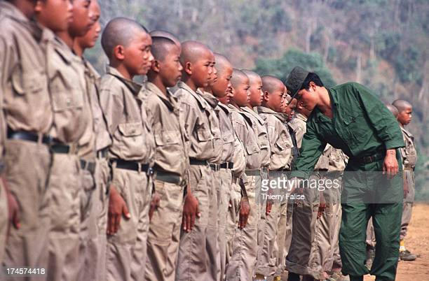 Childsoldiers of the Mong Tai Army drug warlord Khun Sa's army during tough training with their commander