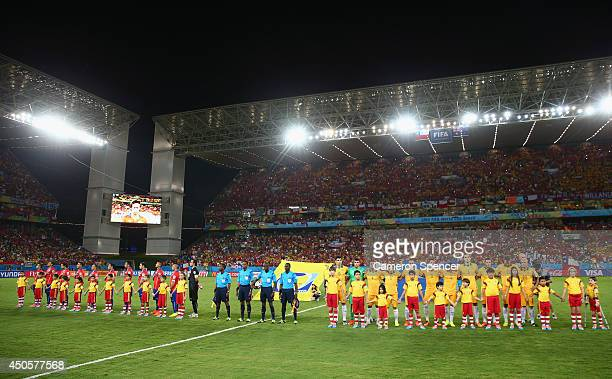 Chile and Australia line up for the National Anthems prior to the 2014 FIFA World Cup Brazil Group B match between Chile and Australia at Arena...
